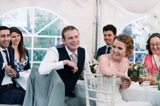solihull wedding photography, bride & groom laughing during the speeches at the elephant & castle rowington