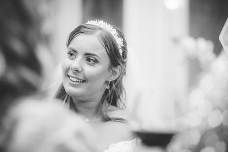 Hampton Manor Wedding Photographer Solihull, Natural photograph of the bride during the speeches, fun, relaxed photograph