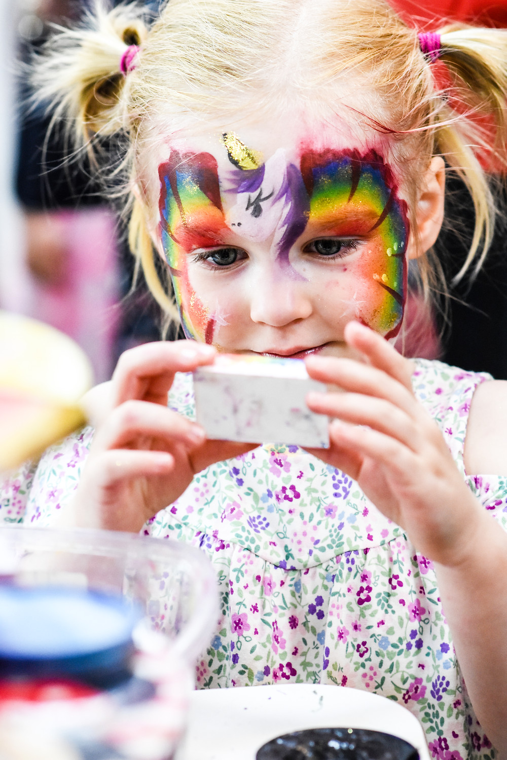Wedding Photographer Solihull, Birmingham, little girl with face paint, taking a selfie