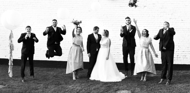 Wedding Photographer Solihull, the bridal party jumping against a white wall, pub wedding photographer Birmingham