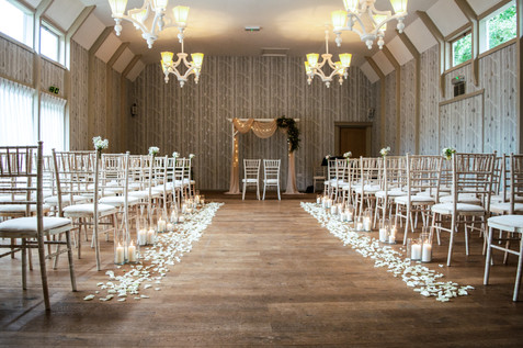 Hampton Manor Wedding Photographer Solihull, the rustic barn ceremony room before the guests enter