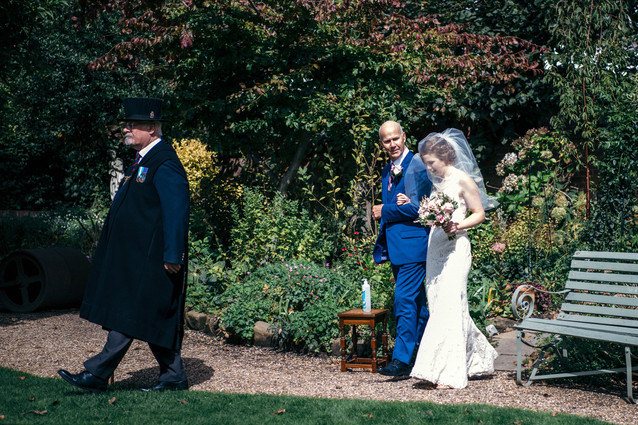 Photographer Wedding Birmingham, bride with her father walking down the aisle at the lord leycester Warwick wedding