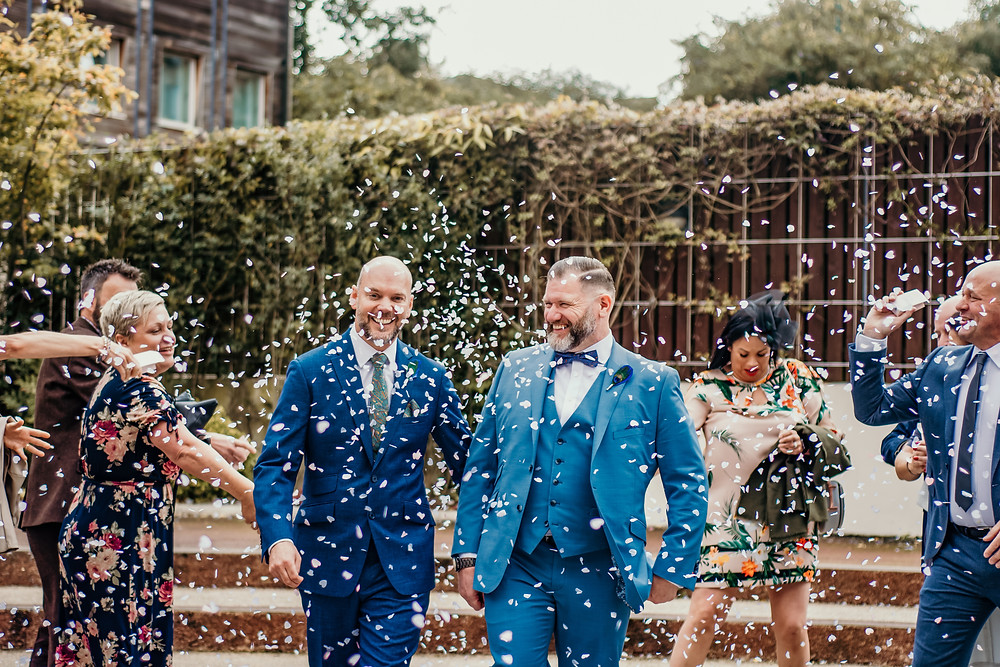 Wedding Photographer Solihull, Birmingham, civil ceremony photographer, the grooms getting covered in confetti after the ceremony
