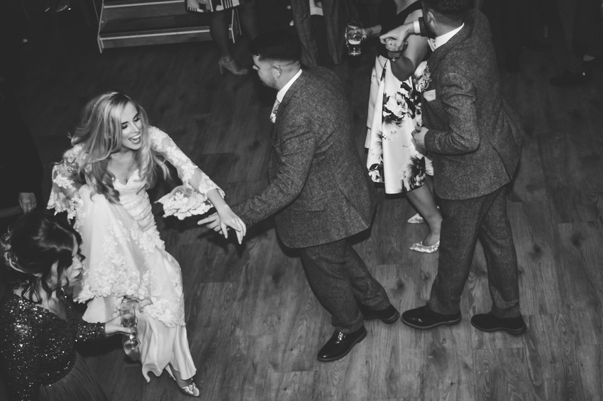 Wedding Photographer Solihull, bride & groom having fun dancing at their wedding, shot from above in black & white at Wootton Park in Warwickshire