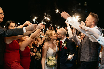 Wedding photographer Birmingham, the bride & groom kissing under the sparkler exit at the Westmead hotel Redditch