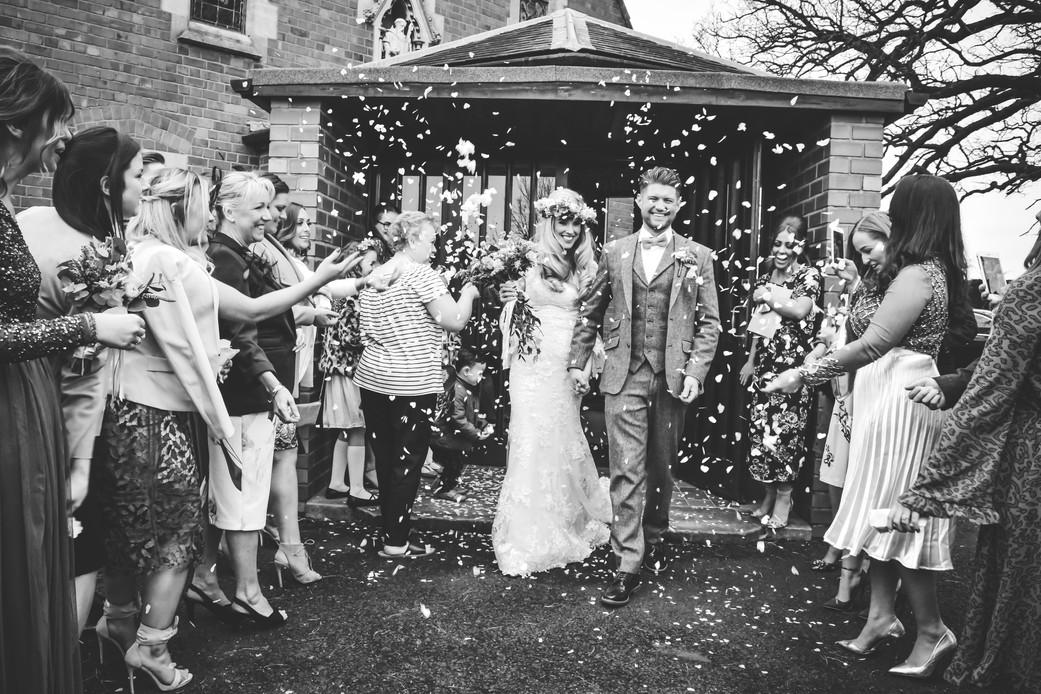 Wedding Photographer Birmingham, the confetti photograph of the bride & groom