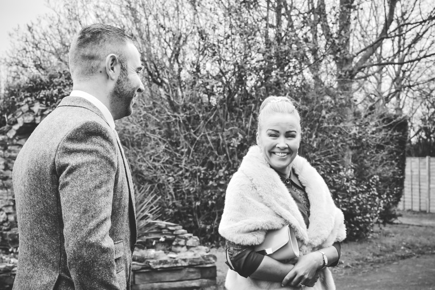Wedding Photographer Birmingham, wedding guests sharing a joke at Wootton Park Warwickshire