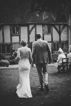Photography wedding Birmingham, black & white image of the bride & groom walking away from the camera at the lord leycester Warwick wedding venue