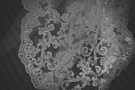Birmingham Wedding Photographer, close up detail of the brides wedding trail on her dress at Westmead hotel Birmingham