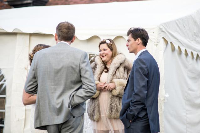 Photography wedding Birmingham, wedding guests chatting, informal wedding photography at the elephant & castle Warwickshire