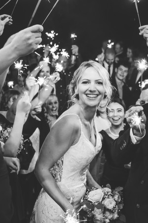 Wedding Photographer Solihull, close up image of the bride on the evening under the sparklers at the Westmead hotel Redditch