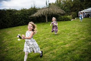 Photography wedding Birmingham, flower girls running, playing at a wedding at the elephant & castle rowington