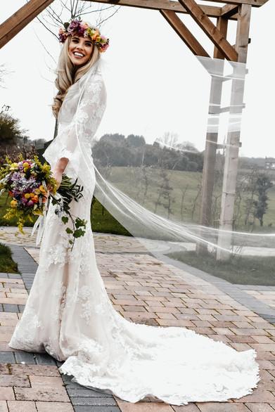 Wedding Photographer Birmingham, boho bride full length fun photograph at Wootton Park Henley in Arden