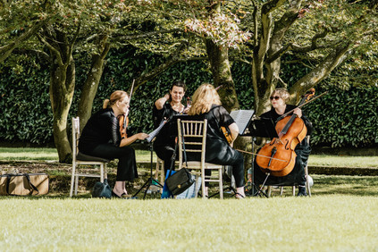 Hampton Manor Photography Solihull, string quartet photograph playing in the grounds of the venue