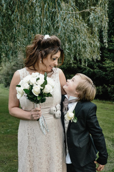 The Limes Wedding Photographer Solihull, Wedding Photographer Birmingham, relaxed image of a bride looking at her young son at her wedding