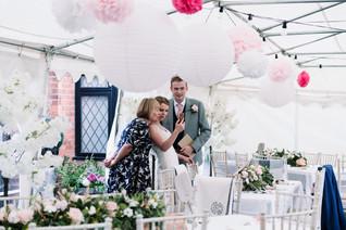 Wedding Photography Birmingham UK, the bride & groom on the phone at their wedding reception at the elephant & castle rowington