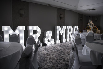 Wedding Photographer Solihull, lite up wedding sign saying mr & mrs at the evening reception at the Westmead hotel Redditch