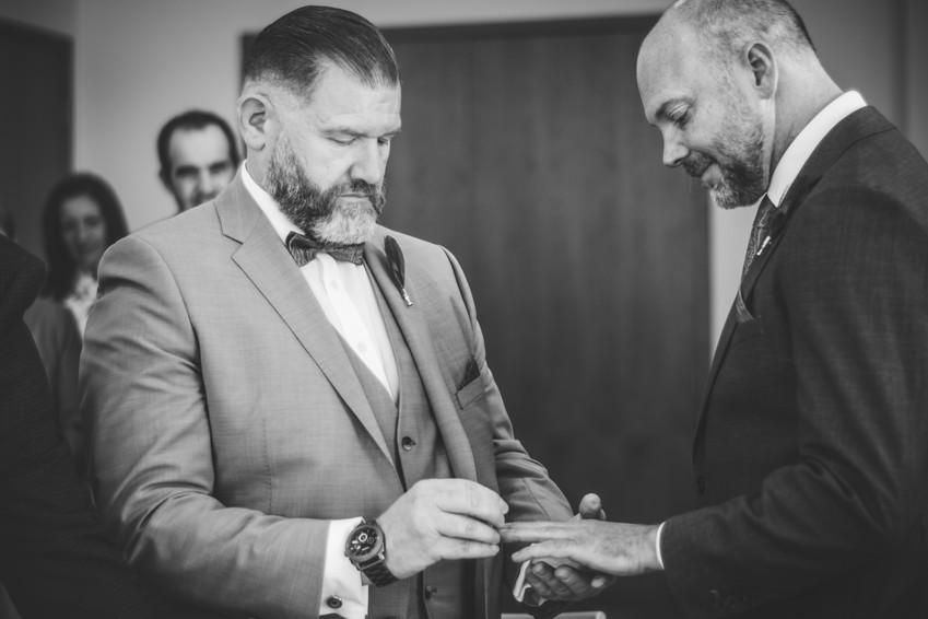 Birmingham Register Office Wedding Photographer Birmingham, the grooms exchanging rings during the wedding ceremony