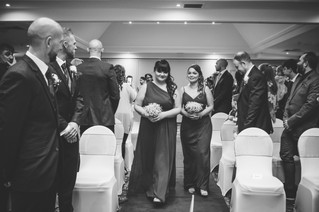 Wedding Photographer Solihull, the bridesmaids walking down the aisle before the bride at the wedding ceremony at Westmead hotel Birmingham