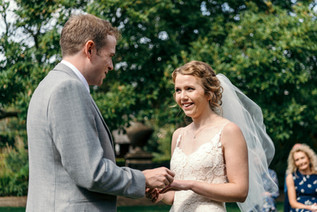 Lord Leycester Warwick wedding, bride & groom exchanging vows at an outdoor wedding, photographer wedding solihull