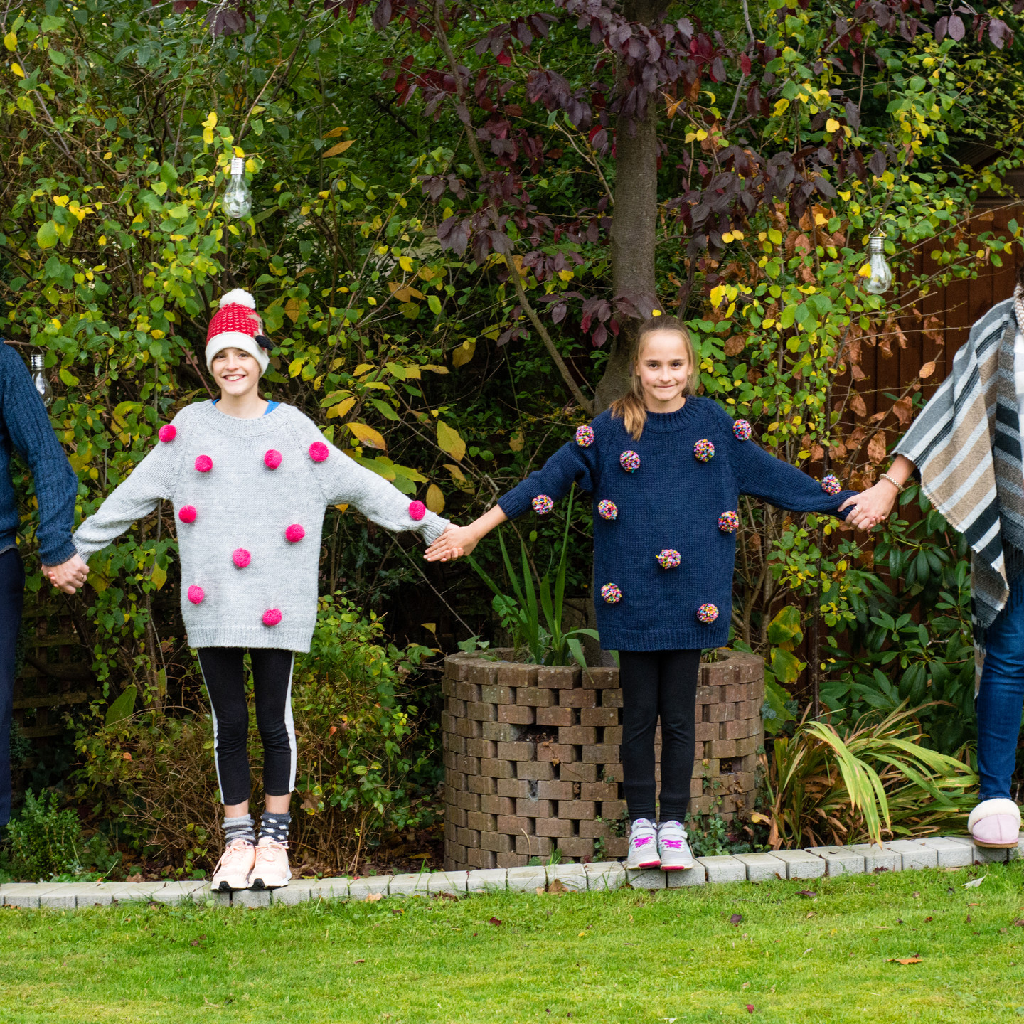 Family Photographer Solihull, family photo shoot in the back garden fun natural photograph holding hands