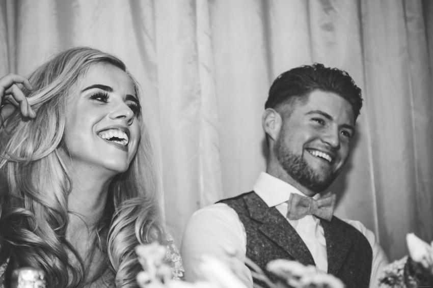 Birmingham Wedding Photographer, the bride & groom laughing during the wedding speeches at wootton Park Warwickshire