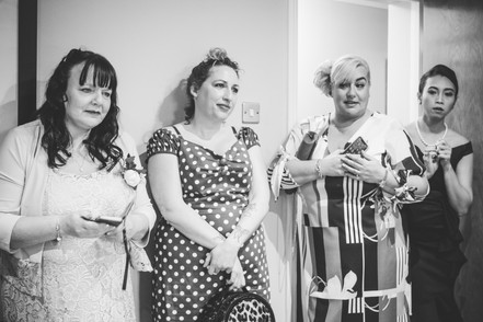 Fun wedding photographer Birmingham, natural photograph of the brides friends watching her get ready during the preps at Westmead hotel Birmingham