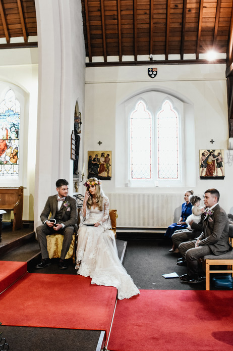 Wedding Photographer Birmingham, bride & groom during the ceremony, natural fun image