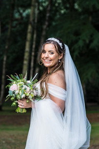 Wedding Photographer Hampton Manor Solihull, natural photograph of the bride at her wedding