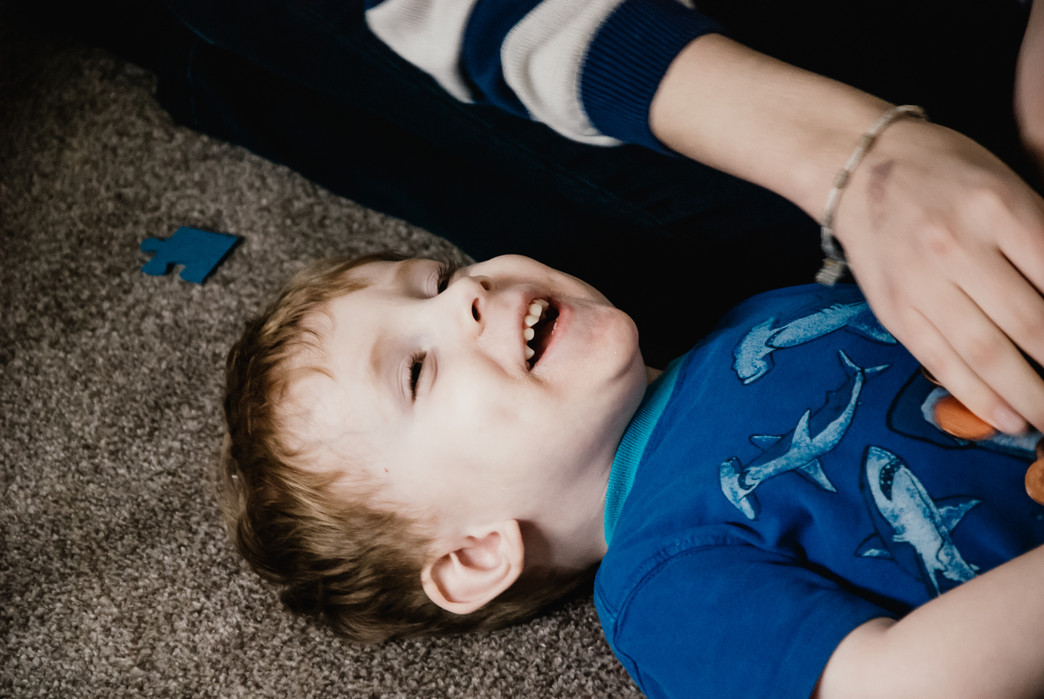 Lifestyle Photographer Birmingham, little boy laughing at home photograph