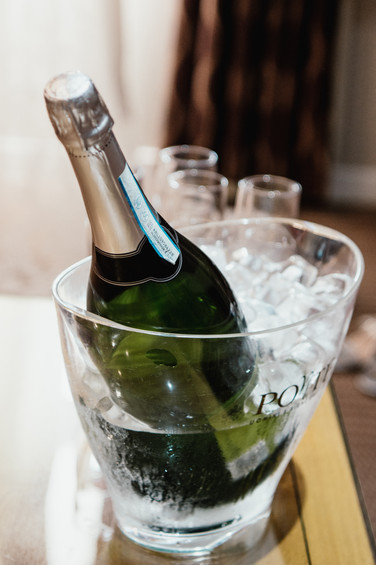 Birmingham Wedding Photographer, a bottle of champagne in ice at the Westmead hotel Birmingham