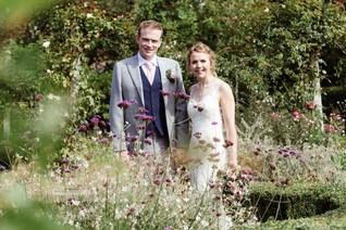 Photographer wedding Birmingham,bride & groom portraits in the garden at the lord leycester hospital wedding venue Warwick