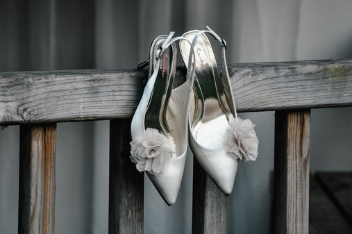 The Limes Solihull Wedding Photographer, Wedding Photographer Birmingham, the brides wedding shoes on the outdoor area decking