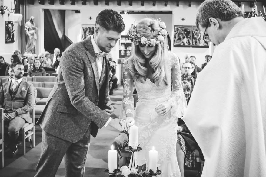 Wedding Photographer Birmingham, bride & groom lighting a candle during the catholic ceremony