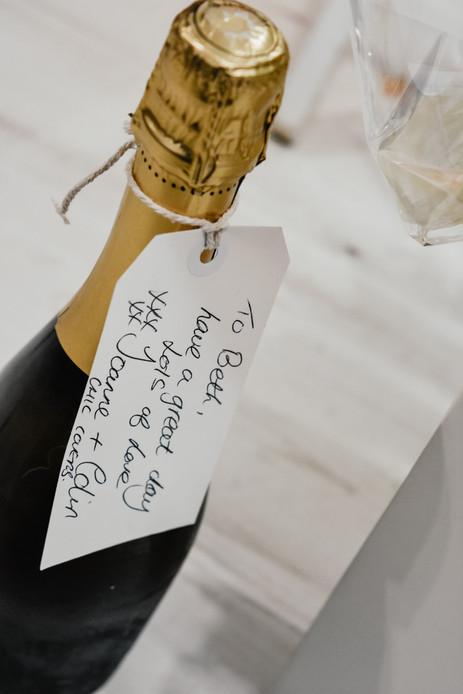 Wedding Photographer Birmingham, bottle of champagne for the bride, Wootton Park Wedding Photographer Warwickshire