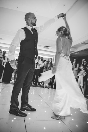 Birmingham wedding photographer, the bride & groom dancing to the first dance at the Westmead hotel Redditch