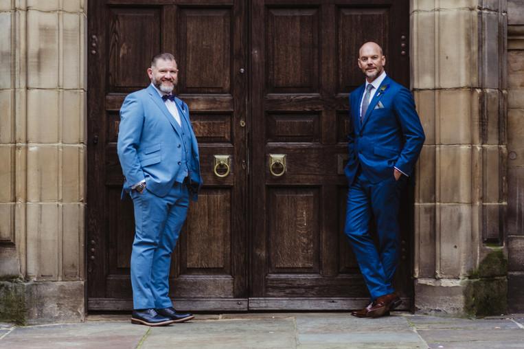 Civil Wedding Wedding Photographer Birmingham, the grooms standing outside a doorway, informal, fun photograph