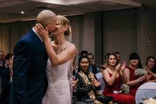 Wedding Photographer Solihull, the first kiss as newlyweds, bride & groom at the Westmead Birmingham