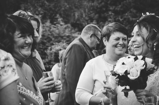 The Limes Wedding Photographer Solihull, Wedding Photographer Birmingham, bride laughing with her guests, natural black & white image