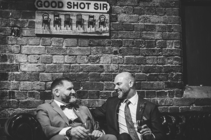 52 Gas Street, Civil Wedding  Photographer Birmingham, the grooms looking at each other, relaxed photograph in black & white