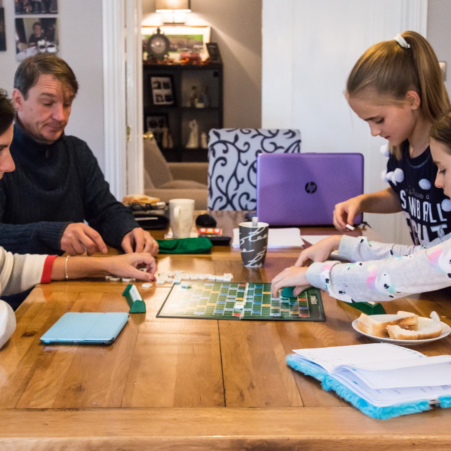 Birmingham family photography, lifestyle photograph of a family playing a board game together