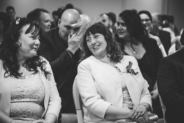 Wedding Photographer Birmingham, guests laughing during the wedding ceremony at the Westmead Birmingham
