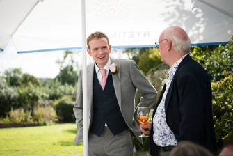 Photography wedding Birmingham, wedding guests chatting, informal wedding photography at the elephant & castle Warwickshire, groom with guest