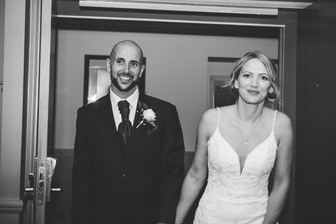 Birmingham wedding photographer, The rie & groom entering the wedding breakfast room at the Westmead hotel Redditch