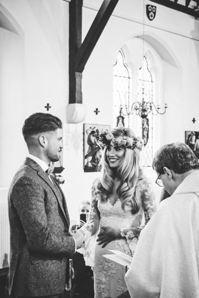 Wedding Photographer Birmingham, bride & groom exchanging vows during the ceremony