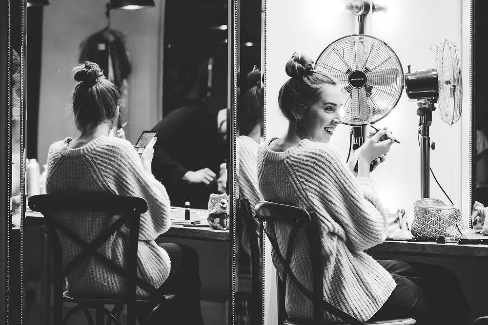 Wedding Photographer Solihull, black & white photograph of a bride doing her own makeup before she gets married
