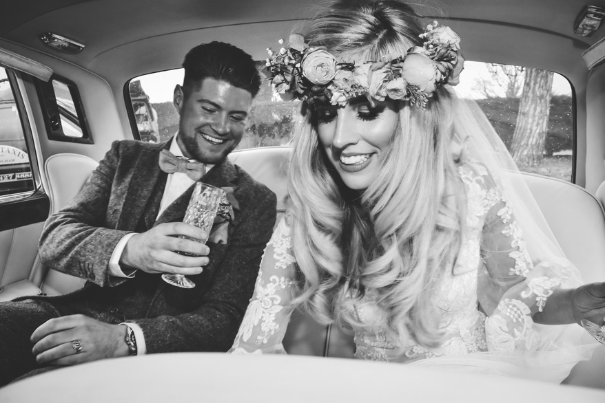 Fun Wedding Photography Birmingham, the bride & groom in their vintage wedding car after they got married, natural wedding photograph