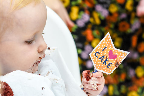Family Photographer Solihull, little girl at her brithday party with cake on her face