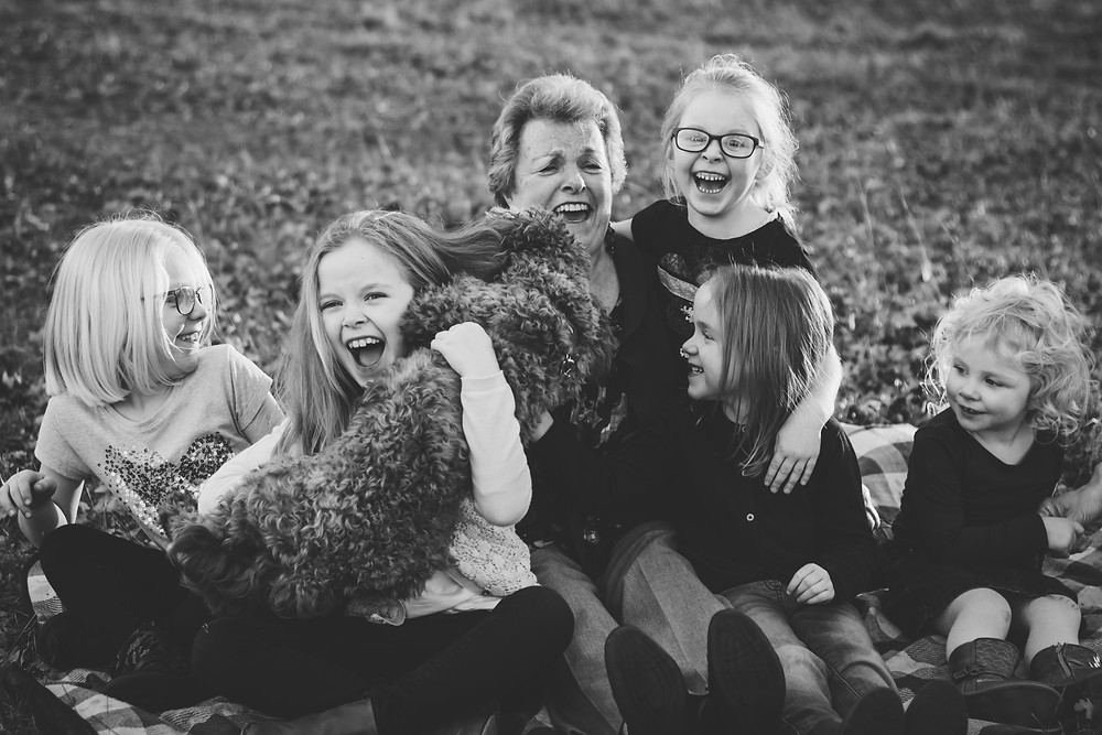 Family Photographer Birmingham, grandma & her granddaughters & a dog, fun, natural photograph outdoors, informal black & white photo