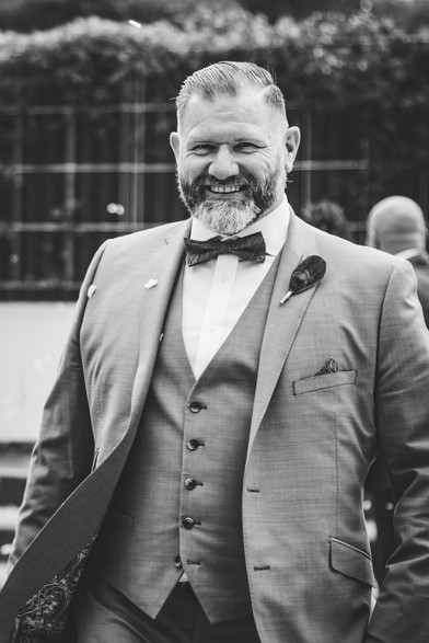 Same sex wedding photographer Birmingham, the groom laughing, nice relaxed black & white photograph